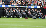 Jose Mourinho , the Manchester Utd manager (2nd left on first row) sits in the dugout alongside all his assistants, coaching and back room staff during the game. Premier league match, Swansea city v Manchester Utd at the Liberty Stadium in Swansea, South Wales on Saturday 19th August 2017.<br /> pic by  Andrew Orchard, Andrew Orchard sports photography.