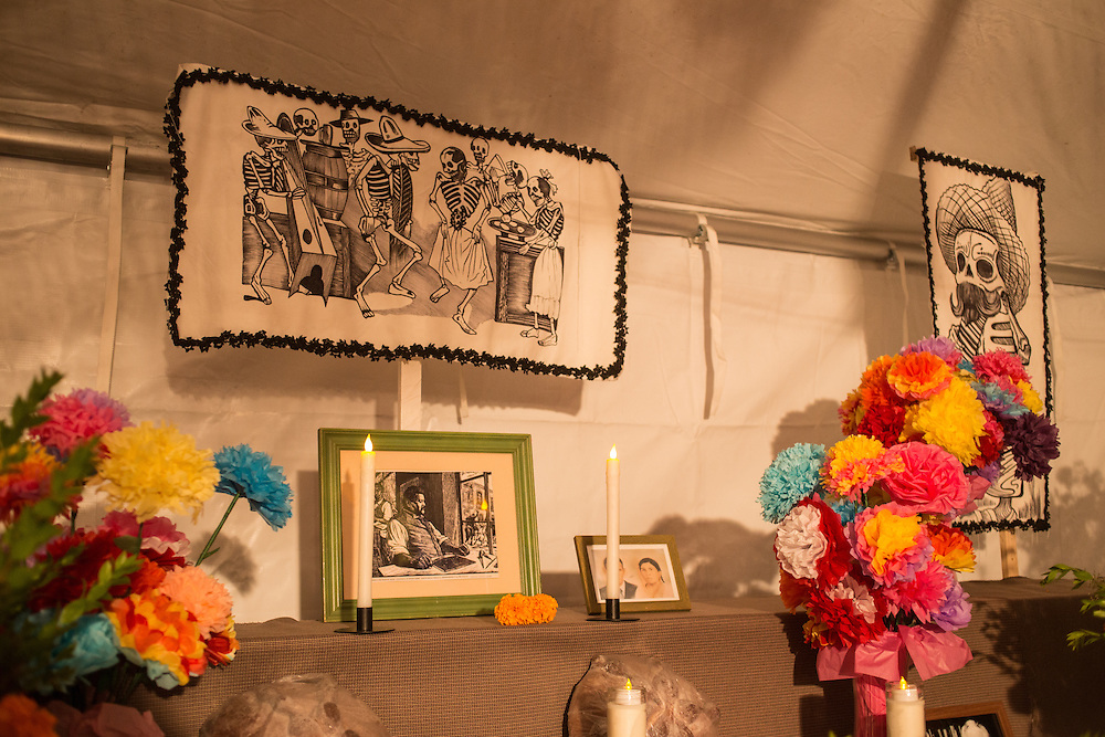 New York, NY, October 31, 2013. Illustrations by José Guadalupe Posada are on the back wall of the tent. 2013 marks the 100th anniversary of the death of this influential illustrator.