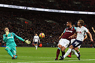 Harry Kane of Tottenham Hotspur's (R) has a shot at goal saved by Adrian, the goalkeeper of West Ham United (L). Premier league match, Tottenham Hotspur v West Ham United at Wembley Stadium in London on Thursday  4th January 2018.<br /> pic by Steffan Bowen, Andrew Orchard sports photography.