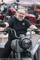 Jack Dlude of Montreal Canada checks out a new 2017 Road King Special at the Harley-Davidson display at the Daytona Speedway during Daytona Bike Week. Daytona Beach, FL. USA. Monday March 13, 2017. Photography ©2017 Michael Lichter.