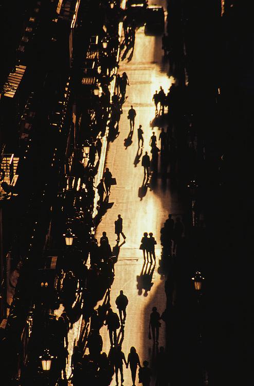Europe, Italy, Rome, shoppers on Via Condotti fashion street in silhouette
