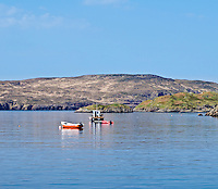 Boats moored at Tarbet with Handa island in distance, Tarbet, Sutherland, Scotland