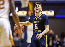 Feb 9, 2019; Morgantown, WV, USA; West Virginia Mountaineers guard Jordan McCabe (5) calls out a play during the second half against the Texas Longhorns at WVU Coliseum. Mandatory Credit: Ben Queen-USA TODAY Sports