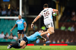 March 23, 2019 - Sydney, NSW, U.S. - SYDNEY, NSW - MARCH 23: Crusaders player David Havili (15) breaks the tackle of Waratahs player Bernard Foley (10) at round 6 of Super Rugby between NSW Waratahs and Crusaders on March 23, 2019 at The Sydney Cricket Ground, NSW. (Photo by Speed Media/Icon Sportswire) (Credit Image: © Speed Media/Icon SMI via ZUMA Press)