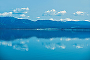 Coudes reflected in Kluane Lake. Ruby Range Mountain<br />