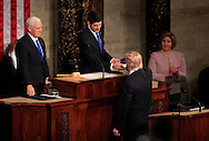 President Donald Trump shakes hands with Speaker of the House Paul Ryan before  gives a speech to a joint session of Congress on February 28, 2017<br /> <br /> Photo by Dennis Brack