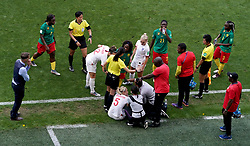 Match referee Qin Liang (third left) intervenes after Cameroon's Alexandra Takounda (fifth right) fouls England's Steph Houghton (5) during the FIFA Women's World Cup, round of Sixteen match at State du Hainaut, Valenciennes.