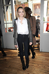 CARA DELEVINGNE at a party to celebrate the 1st anniversary of Alice Temperley's label held at Paradise, Kensal Green, London W10 on 25th November 2010.