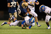 Sky Walker (33) of the McKinney Christian Academy Mustangs is tackled by Bradley Bilbo (19) of the Dallas Lutheran Lions at McKinney North High School in McKinney on Friday, September 13, 2013. (Cooper Neill/Special Contributor)