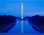 The Washington Monument viewed at dawn from the steps of the Lincoln Memorial, Washington, District of Columbia.