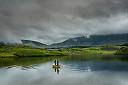 It was one of those dreary days in North Wales; the clouds hadn't lifted once and light drizzle dampened you from every angle. I happened upon this mountain lake where a father & son (I think from listening to them) were fly fishing from their little boat. I stood in silence in this tranquil Welsh scene, mesmerised by their action of casting lines out over the surface, a skill indeed. After a short while I found myself smiling though, as just beyond the ripples of movement from the boat and beyond the furthest reach of their bait, I noticed several large fish safely jumping for midges. Clever Welsh fish.