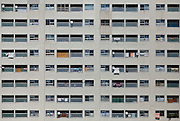 Detail image of a typical Japanese apartment building with laundry and satellite dishes on the balconies. Ebisu, Tokyo, Japan. Friday May 30th 2014