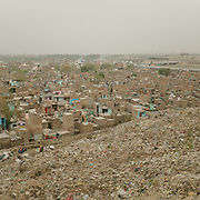 View from the garbage dump, over the Bhalswa district, north Delhi, a village located right below one of the giant open air garbage dump which burns 24/7, creating toxic fumes.