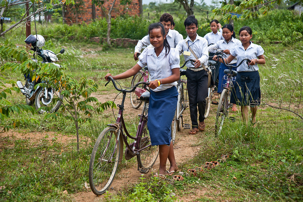 Chheu Teal Korng village:.Remarkable how much CWS has accomplished here in less than a.year, because they are working with such a willing and committed local committee.  Schoolgirls taking bicycles to school.