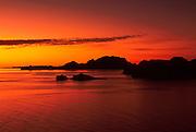 MEXICO, BAJA CALIFORNIA SOUTH Sea of Cortez near Loreto with the rocky Isla Danzante in the background at sunrise