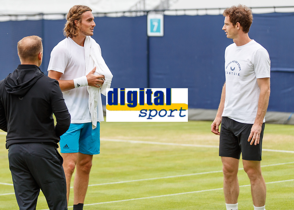Tennis - 2019 Queen's Club Fever-Tree Championships - Day Three, Wednesday<br /> <br /> Men's Singles, First Round: Juan Martin Del Potro (ARG) Vs. Denis Shapovalov (CAN)<br /> <br /> Andy Murray (GBR) chats with Stefanos Tsitsipas (GRC) on the practice courts.<br />  <br /> COLORSPORT/DANIEL BEARHAM