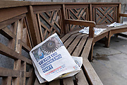 Copies of newspapers showing yesterday's news, and a government's ad warning that time is running out for businesses who should be preparing for a UK Brexit on 1st January 2021, discarded on a bench outside the Bank of England in the City of London, the capital's financial district, during the second wave of the Coronavirus pandemic, on 20th October 2020, in London, England. The capital is designated by the government as a Tier 2 restriction.
