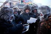 Salespeople on the Yakutsk outdoor fish market are looking to photographs I made two years ago of them and seem to be very happy to receive their promised photograph. Yakutsk is a city in the Russian Far East, located about 4 degrees (450 kilometres) south of the Arctic Circle. It is the capital of the Sakha (Yakutia) Republic in Russia with a major port on the Lena River. The city has a population of 264.000 (2009). Yakutsk is one of the coldest cities on Earth. The average monthly winter temperature in January is around -43,2 C. Yakutsk, Jakutsk, Yakutia, Russian Federation, Russia, RUS, 16.01.2010.