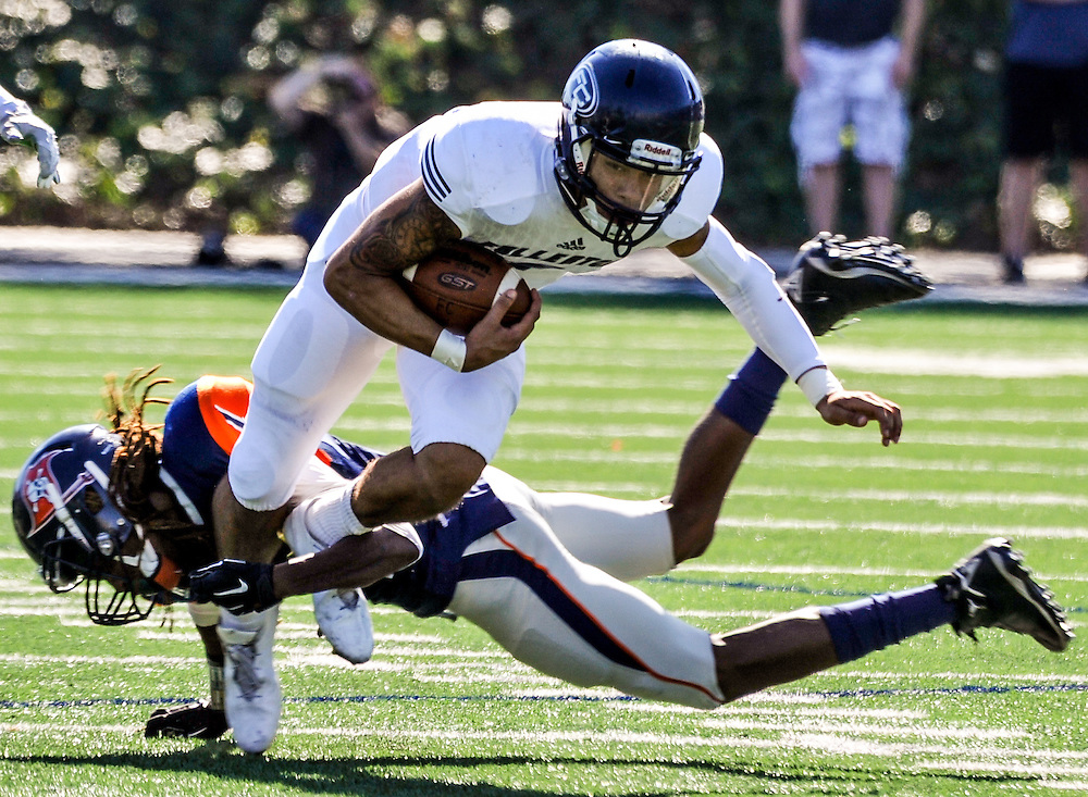 song_sat_0210- Fullerton College quarterback Jordan Hoy breaks a tackle during the first quarter of their game against Orange Coast College. November 5th, 2016 — Fullerton College vs Orange Coast College — Men's Football — Costa Mesa, CA<br /> <br /> Photo by Austin Song / Sports Shooter Academy 13