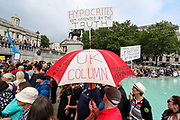 """London, United Kingdom, July 24, 2021: Thousands of people holding banners and placards gathered in Trafalgar during an """"anti-Lockdown"""" demonstration in central London, on Saturday, July 24, 2021. (VX Photo/ Vudi Xhymshiti)"""
