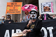 Compere leads the Walk of Shame disruptive mach through the City of London by environmental group Extinction Rebellion on 4th September 2020 in London, United Kingdom. The walk visited various locations in the financial district, to protest against companies and institutions with historical links to the slave trade, or who finance or insure projects which are seen as ecologically unsound. The message by the group is that 'apologies and token attempts at diversity are not enough to address this legacy and present reality. Our demand is reparations and reparatory justice for those affected by colonial and neo-colonial exploitation'. Extinction Rebellion is a climate change group started in 2018 and has gained a huge following of people committed to peaceful protests. These protests are highlighting that the government is not doing enough to avoid catastrophic climate change and to demand the government take radical action to save the planet.