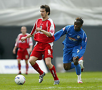 Photo: Chris Ratcliffe.<br />Leyton Orient v Grimsby Town. Coca Cola League 2. 17/04/2006.<br />Craig Easton (L) of Leyton Orient gets away from Jean-Paul Kalala of Grimsby