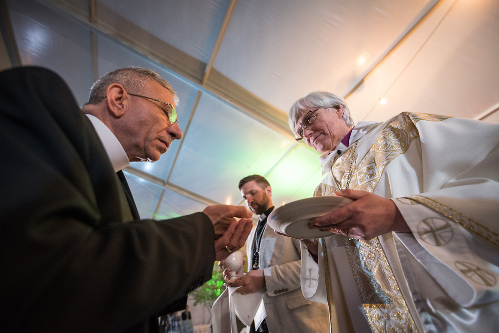 """16 May 2017, Windhoek, Namibia: Outgoing Lutheran World Federation president bishop Munib Younan from the Evangelical Lutheran Church in Jordan and the Holy Land receives Holy Communion. Reaching the end of the Lutheran World Federation's Twelfth Assembly, Church of Sweden Archbishop Rev. Dr Antje Jackelén presided over the Eucharist at closing worship. As the Twelfth Assembly of the Lutheran World Federation is coming to an end, a closing worship service celebrates the LWF Communion and a successful Assembly, and installing the newly elected LWF Council and President. The Twelfth Assembly of the Lutheran World Federation gathers in Windhoek, Namibia, on 10-16 May 2017, under the theme """"Liberated by God's Grace"""", bringing together some 800 delegates and participants from 145 member churches in 98 countries."""
