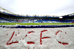 The letters LCFC written in the snow in the stands before kick-off