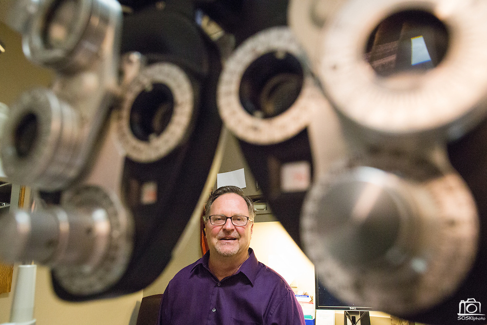 Owner Raymond Pedersen, OD, poses for a portrait, framed through a phoropter, at Capitol Eye Care Center in Fremont, California, on April 10, 2014. Pedersen has been in business since 1987. (Stan Olszewski/SOSKIphoto)