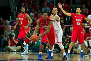 DALLAS, TX - JANUARY 4: Sterling Brown #3 of the SMU Mustangs is defended by Shabazz Napier #13 of the Connecticut Huskies on January 4, 2014 at Moody Coliseum in Dallas, Texas.  (Photo by Cooper Neill) *** Local Caption *** Sterling Brown; Shabazz Napier