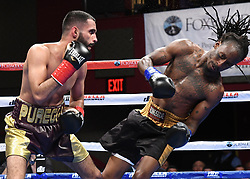 May 5, 2018 - Mashantucket, CT, U.S. - MASHANTUCKET, CT - MAY 05: Khalid Twaiti  (red tape)  battles Joseph Cole  (blue tape) during their bout on May 5, 2018 at the Foxwoods Fox Theater in Mashantucket, Connecticut. Khalid Twaiti defeated Joseph Cole via KO of Round 3. (Photo by Williams Paul/Icon Sportswire) (Credit Image: © Williams Paul/Icon SMI via ZUMA Press)