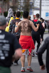 A man literally wearing a hair shirt makes his way along Divisidero at the 107th running of the Bay to Breakers, Sunday, May 20, 2018, in San Francisco. (Photo by D. Ross Cameron)