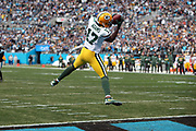 Green Bay Packers wide receiver Davante Adams (17) leaps and catches a 13 yard pass for a first quarter touchdown that ties the score at 7-7 during the 2017 NFL week 15 regular season football game against the Carolina Panthers, Sunday, Dec. 17, 2017 in Charlotte, N.C. The Panthers won the game 31-24. (©Paul Anthony Spinelli)