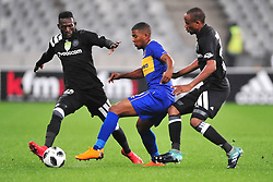 Cape Town 180314.Cape Town City winger Lyle Lakay  tackled by Augustine Mulenga and Xola Mlambo of Orland Pirates in  a Nedbank  game taking place at the Cape Town Stadium. City won the game 1-0 by a goal scored by Ayanda Patosi .Photograph:Phando Jikelo/AFRICAN NEWS AGENCY/ANA