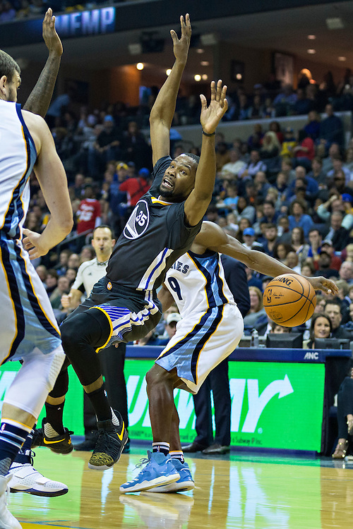 MEMPHIS, TN - DECEMBER 10:  Kevin Durant #35 of the Golden State Warriors is fouled going up for a shot during a game against the Memphis Grizzlies at the FedExForum on December 10, 2016 in Memphis, Tennessee.  The Grizzlies defeated the Warriors 110-89.  NOTE TO USER: User expressly acknowledges and agrees that, by downloading and or using this photograph, User is consenting to the terms and conditions of the Getty Images License Agreement.  (Photo by Wesley Hitt/Getty Images) *** Local Caption *** Kevin Durant