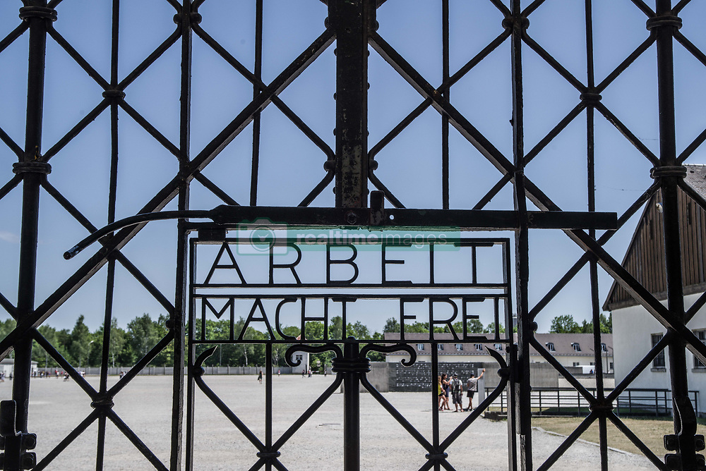 """July 21, 2017 - Dachau, bavaria, germany - (photo: Sachelle Babbar) The head of the SPD and Kanzlerkandidat (candidate for the Chancellorship of Germany) visited the Dachau concentration camp grounds in order to pay respects on behalf of his SPD party to the victims of National Sozialism.  Schulz then presented a memorial plaque (followed by a moment of silence) with inscriptions honoring the victims and those who defend democracy. At the end of the tour, a wreath was laid down at the International Memorial by Schulz, Markus Rinderspacher, Uli Grötsch, and Michael Schrodi. Other speakers included Dr. Gabrielle Hammermann of the Dachau Memorial..The Dachau Concentration Camp Memorial Grounds lie approximately 20km north of Munich.  The camp eventually came a """"model"""", which other camps were designed after.  It was in operation from March 1933- April 1945 and 31,951 were reported as killed there.  Dachau recently received international attention when the iconic """"Arbeit macht Frei"""" gate was stolen in 2014, then recovered in Norway in 2016, and returned to the grounds in Feb. 2017. (Credit Image: © Sachelle Babbar via ZUMA Wire)"""