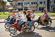16 MARCH 2006 - KAMPONG CHAM, KAMPONG CHAM, CAMBODIA: Motor scooter traffic in the city of Kampong Cham in central Cambodia on the Mekong River. PHOTO BY JACK KURTZ