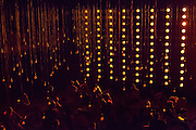 "A wall of orange lights, with pendant bulbs over the audience, in Samuel Beckett's ""All That Fall""."