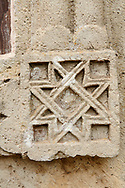 Close up picture & image of the geometric stone bas reliefs on the exterior of the Gelati Georgian Orthodox Church St George, 13th century.  The medieval Gelati monastic complex near Kutaisi in the Imereti region of western Georgia (country). A UNESCO World Heritage Site. .<br /> <br /> Visit our MEDIEVAL PHOTO COLLECTIONS for more   photos  to download or buy as prints https://funkystock.photoshelter.com/gallery-collection/Medieval-Middle-Ages-Historic-Places-Arcaeological-Sites-Pictures-Images-of/C0000B5ZA54_WD0s<br /> <br /> Visit our REPUBLIC of GEORGIA HISTORIC PLACES PHOTO COLLECTIONS for more photos to browse, download or buy as wall art prints https://funkystock.photoshelter.com/gallery-collection/Pictures-Images-of-Georgia-Country-Historic-Landmark-Places-Museum-Antiquities/C0000c1oD9eVkh9c