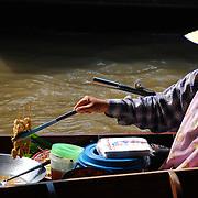 The Dumnoen Saduak Floating Market, a peculiar market place located at Dumnoen Saduak District in the Ratchaburi Province, about 105 kms from Bangkok.