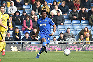 AFC Wimbledon defender Paul Kalambayi (30) looks to release the ball during the EFL Sky Bet League 1 match between Oxford United and AFC Wimbledon at the Kassam Stadium, Oxford, England on 13 April 2019.
