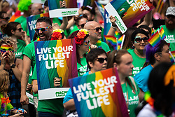 © Licensed to London News Pictures . 05/08/2018. Leeds, UK. Macmillan Cancer Trust on the parade . Leeds Gay Pride parade through the Yorkshire city's centre . Leeds's annual Gay Pride festiva celebrates the city's LGBTQ+ life and culture . Photo credit: Joel Goodman/LNP