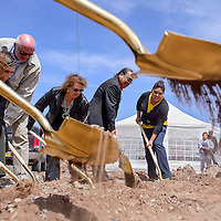 042514       Cable Hoover<br /> <br /> Lynn Canyon, left, Bob Eaton, Marsh Smith, Roscoe Smith,  Memarie Tsosie and a group of other dignitaries dig their shovels into the dirt of the construction site for the new Little Folks Daycare during a groundbreaking ceremony in Navajo Friday.