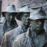 Statues of men forming a line, depicting life during the Great Depression, at the FDR Memorial in Washington DC.