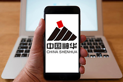 Using iPhone smartphone to display logo of China Shenhua coal based energy company  company