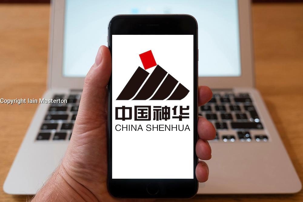 Using iPhone smartphone to display logo of China Shenhua coal based energy company  company