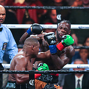 Luis Ortiz (r) lands a shot to the head of Deontay Wilder during the WBC Heavyweight Championship boxing match at Barclays Center on Saturday, March 3, 2018 in Brooklyn, New York. Wilder would win the bout by knockout in the tenth round to retain the title and move to 40-0. (Alex Menendez via AP)