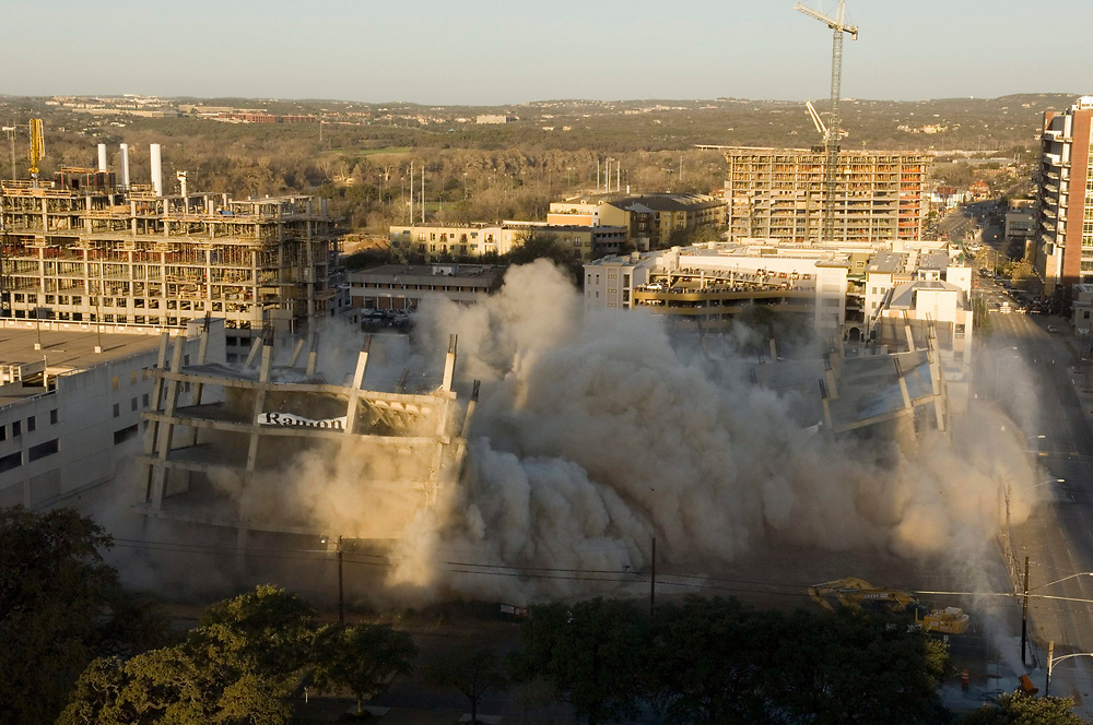 (SEQUENCE 4 of 8) Austin, TX February 25, 2007: The implosion of what was to be an office building for Intel Corp. clears a city block in downtown Austin for a new federal courthouse early Sunday morning. Thousands of Austinites watched the destruction.  ©Bob Daemmrich /