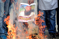 August 28, 2017 - Allahabad, Uttar Pradesh, India - Congress workers burning an effigy and shouting slogans against Baba Ram Rahim as he was held guilty of Rape, in Allahabad. (Credit Image: © Prabhat Kumar Verma via ZUMA Wire)