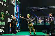 Peter Wright throws in action against Gary Anderson during the Unibet PDC Premier League of darts at Marshalls Arena, Stadium MK, Milton Keynes, England. UK on 7 April 2021.